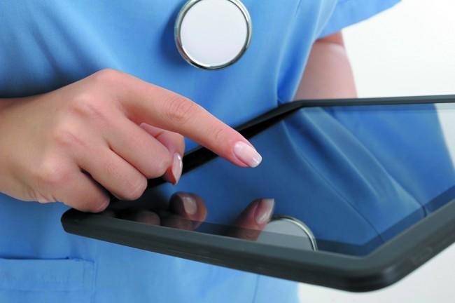 Doctor holding digital tablet